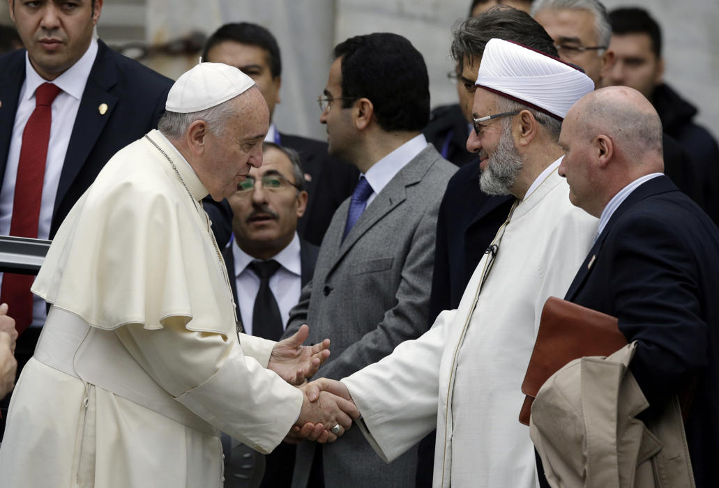 Pope Francis, left, is welcomed by Istanbul Mufti Rahmi Yaran upon their arrival to the Blue Mosque in Istanbul, Turkey, Saturday, Nov. 29, 2014.